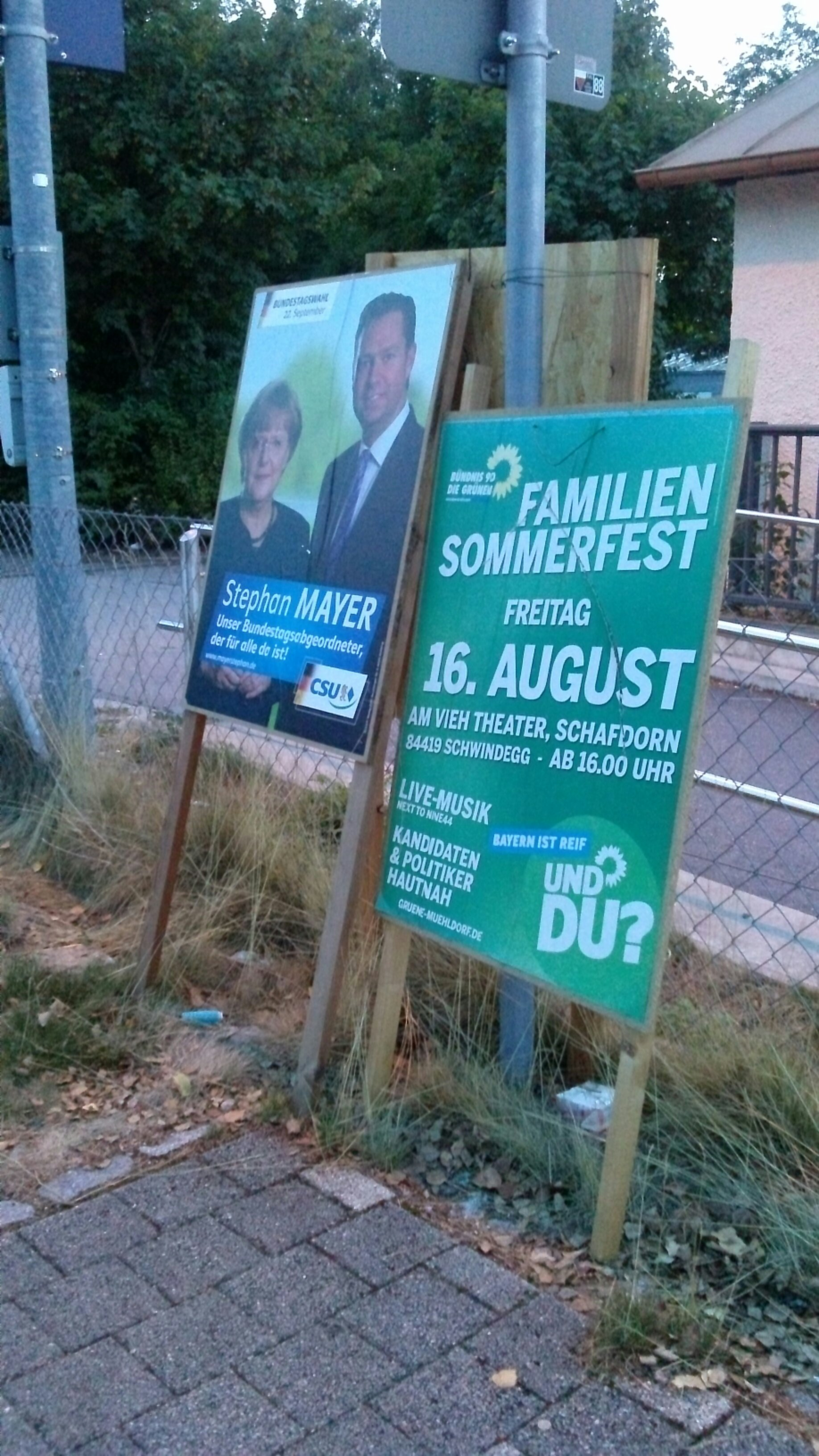 Photo of two election posters next to next